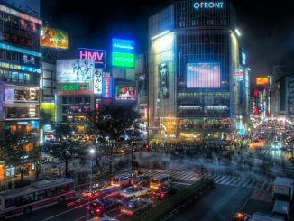 Japan warns of third wave as Covid cases rise