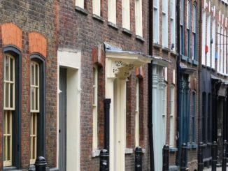 UK house prices reach record high but market set to slow