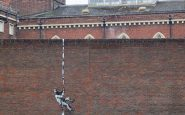 """Banksy confirmed he made new 'escaping inmate"""" street art on side of the prison"""