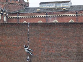 "Banksy confirmed he made new 'escaping inmate"" street art on side of the prison"